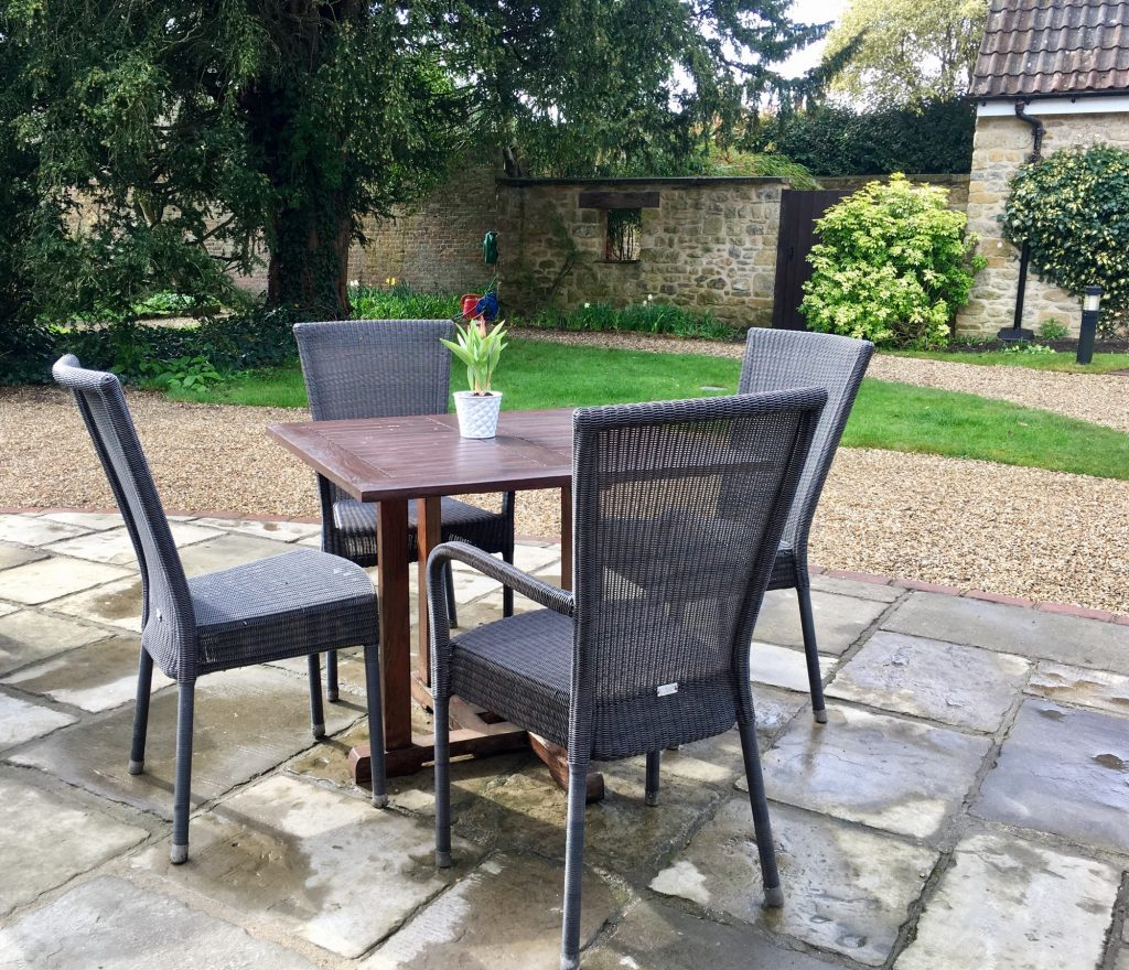 Outdoor living space patio furniture on stone patio